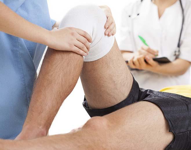 doctor examining patient's knee