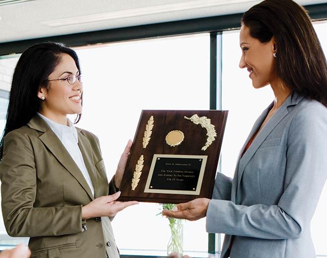 award-executives-applauding-two-women/