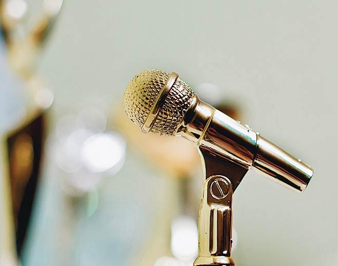 award-gold-mircophone-standing/