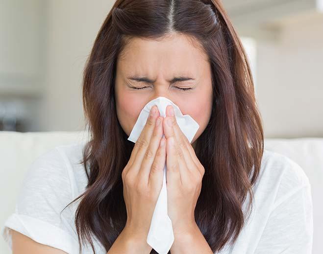 woman-sneezing/